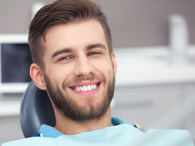 A young man after his implant procedure