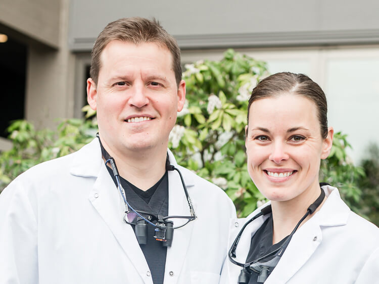Drs. Ryan and Megan Bond in front of their dental office
