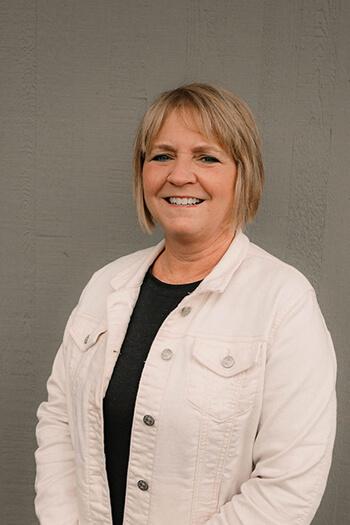 Portrait of Dianna, our front desk manager