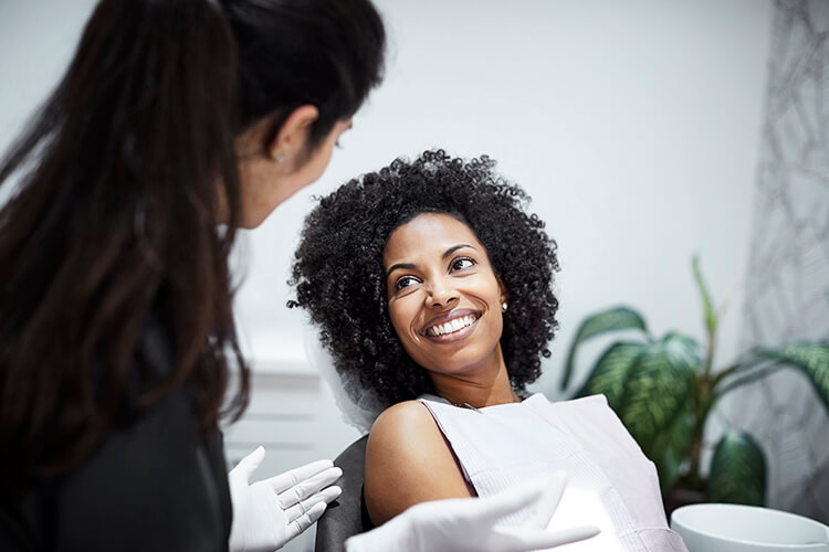 A young woman having a discussion with her dentist