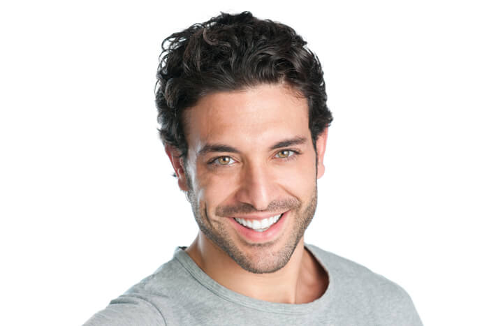 A young man smiling